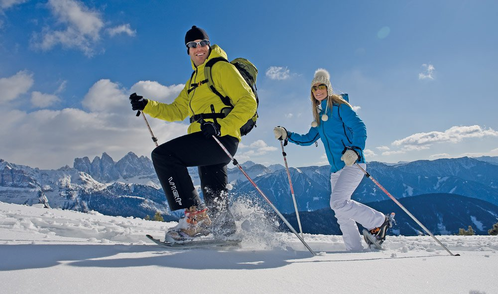Enjoy snow-covered valley while snowshoeing
